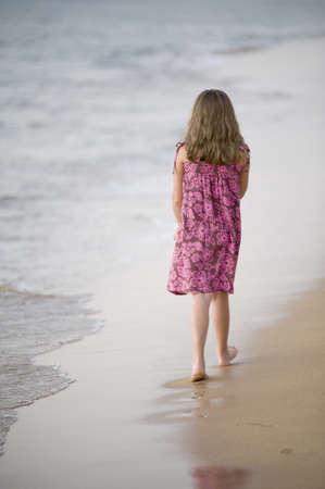 oceanfront: Girl walking on beach, Maui, Hawaii, USA