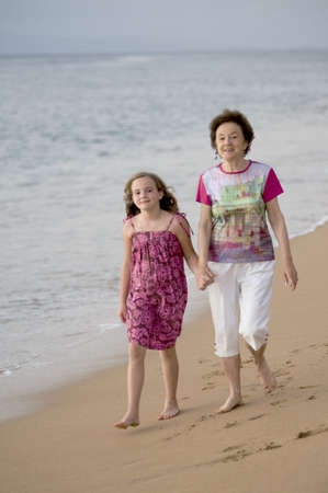 caucasian ancestry: Grandmother and granddaughter at seashore, Maui, Hawaii, USA