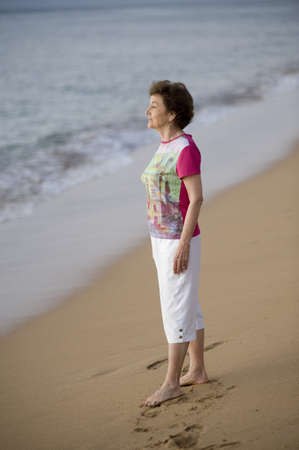 lake fronts: Woman standing on the beach, Maui, Hawaii, USA