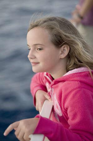 caucasian ancestry: Girl looking over water, Maui, Hawaii, USA