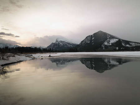 lakeshores: Mountains reflecting in water; Banff, Alberta, Canada