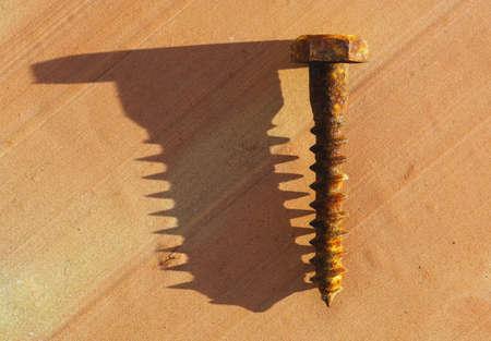 screw: Rusty screw with shadow Stock Photo