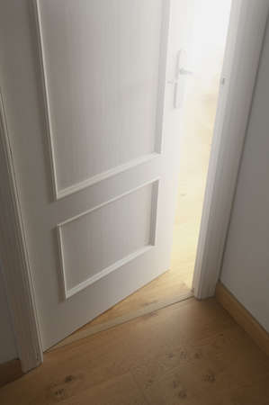 view of a wooden doorway: Door cracked open Stock Photo
