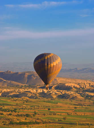 Hot air balloon over Goreme valley, Cappadocia, Anatolia, Turkey Stock Photo - 7194944