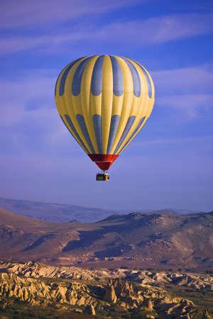 Hot air balloon over Goreme valley, Cappadocia, Anatolia, Turkey photo