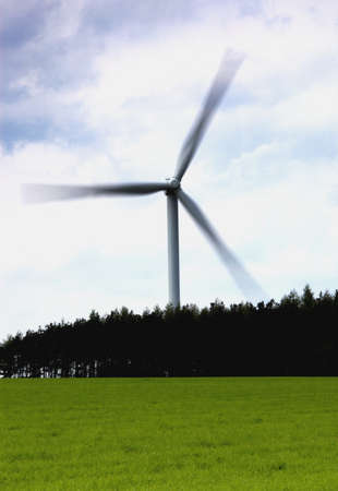 very windy: Wind turbine behind a field of grass, North Yorkshire, England