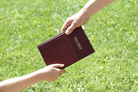preadolescent: Sharing the Bible Stock Photo