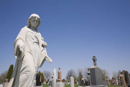 perry: Statue and headstones in cemetery; Laval, Quebec, Canada