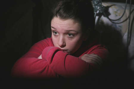 terrorized: Scared teenage girl Stock Photo