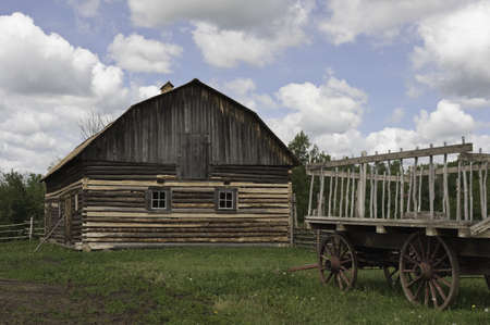 Old fashioned wagon and wood barn