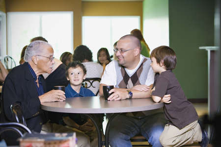 caucasian ancestry: Grandfather, father and grandsons visiting together