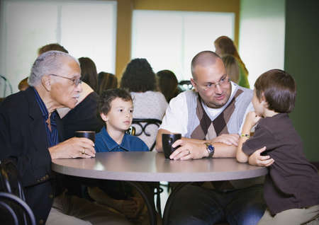 Grandfather, father and grandsons visiting together Stock Photo - 7192859