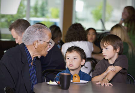 female senior adults: Grandfather and grandsons visiting together Stock Photo