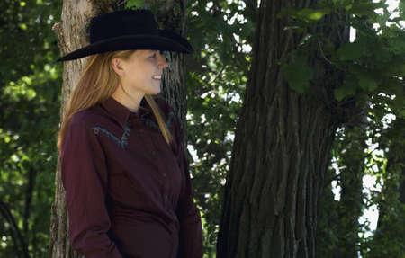 caucasian ancestry: Woman in cowboy hat