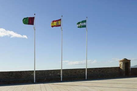 flagpoles: Spanish flags on Gibralfaro Castle, Malaga, Spain