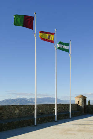 Spanish flags on Gibralfaro Castle, Malaga, Spain Stock Photo - 7190228