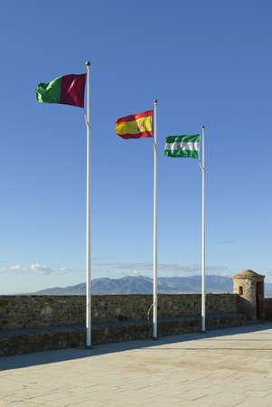 Spanish flags on Gibralfaro Castle, Malaga, Spain Stock Photo - 7191133