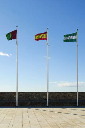 flagpoles: Spain are the Spanish flags of Malaga, Spain and Andalucia, Malaga, Andalucia, Spain