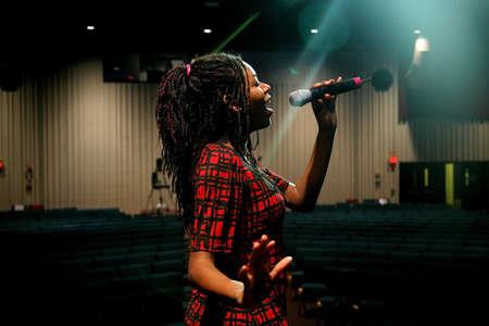 Teenage girl singing photo