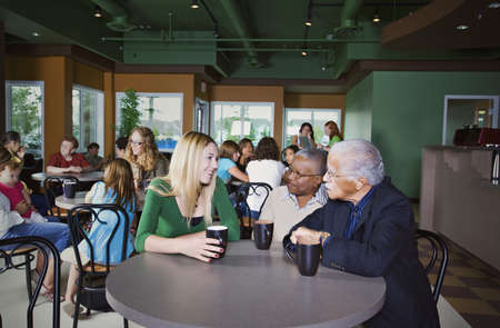 caucasian ancestry: People chatting in cafe Stock Photo