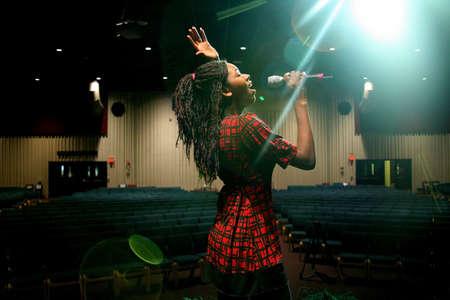 african worship: Teen girl singing
