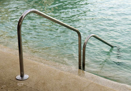 staircases: Hand rail going into pool