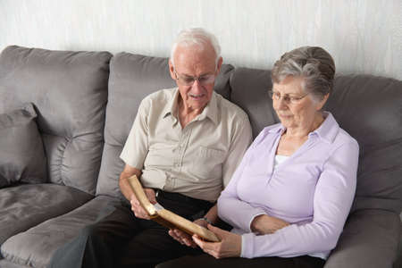 An elderly couple having worship with the Bible photo