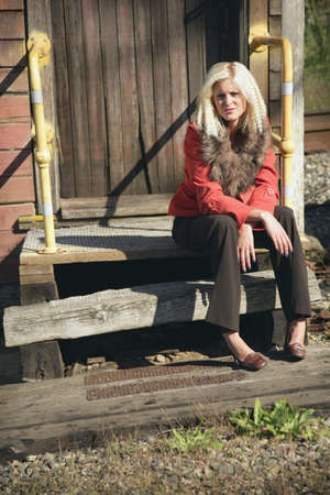 Woman sitting on broken steps photo