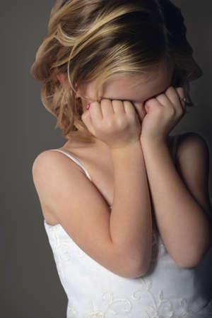 Girl in dress hiding her face Stock Photo