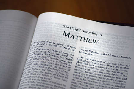 The Bible opened to the book of Matthew photo