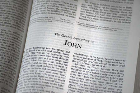 The Bible opened to the book of John Stock Photo - 7196016