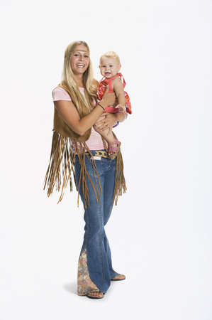 caucasian ancestry: Woman and baby dressed in 1970s clothes Stock Photo