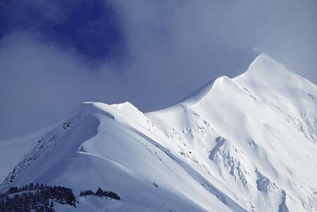 Snow cornice leading up to mountain peak Stock Photo - 7195730