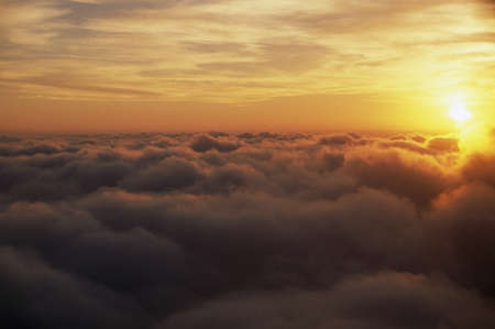 mornings: Sunrise above clouds Stock Photo