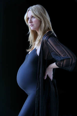 expectant arms: Pregnant woman in black leotard Stock Photo