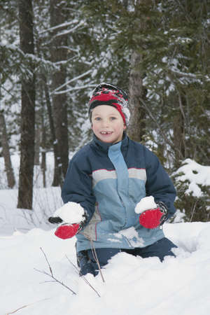 caucasian ancestry: Boy holding a snowball Stock Photo