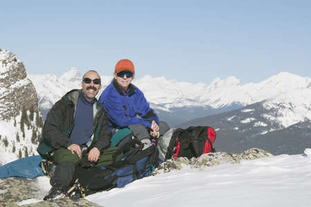Couple sitting on the top of a mountain Stock Photo - 7190083