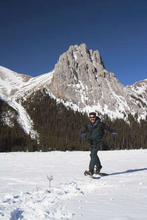 snowshoes: Man in snowshoes in the mountains