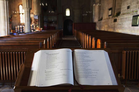 reading material: Open Bible at the front of a church Stock Photo