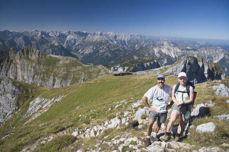 caucasian ancestry: Couple hiking trail on Centennial Ridge, Kananaskis Country, Alberta, Canada Stock Photo