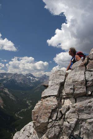 Man sitting on a mountain top enjoying the view