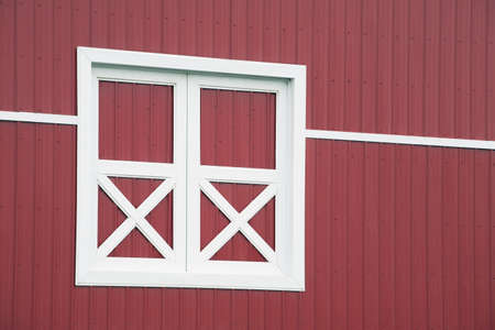 view of a wooden doorway: alberta, canada; red barn and white trim