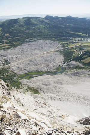 frank: crowsnest pass, alberta, canada; looking down from the mountain peak at frank slide on turtle mountain Stock Photo