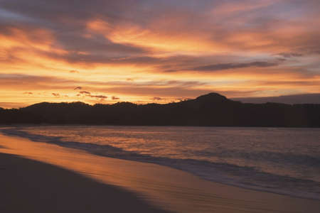 lake fronts: beach at sunset, republic of costa rica