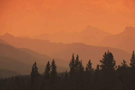 ranges: Silhouette of mountain ranges and orange sky