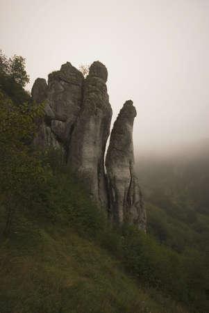 millan: Rocky cliff in the fog Stock Photo