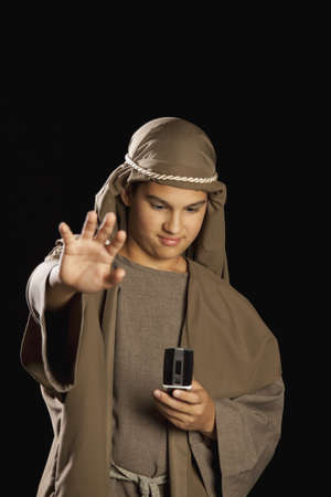 boy depicting jesus holding a cellphone photo