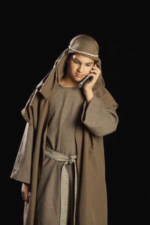 pre teen boy: boy depicting jesus holding a cellphone
