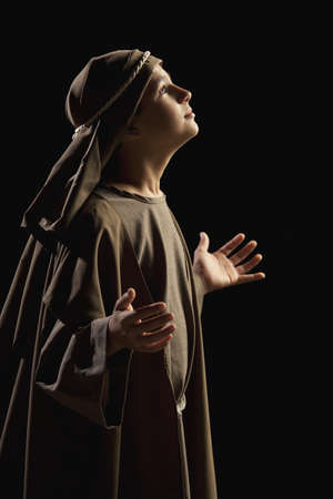 preadolescent: boy portraying a young jesus Stock Photo