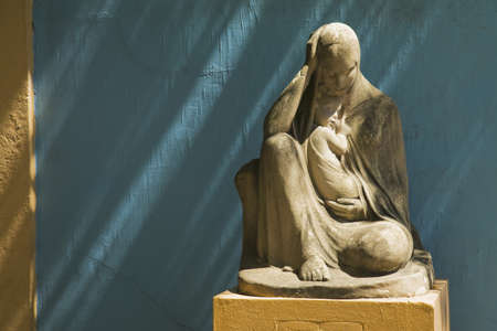 sean: stone statue of the virgin mary holding jesus, buenos aires, argentina Stock Photo